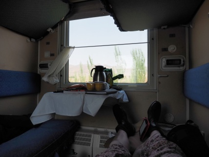 Taking a nap in the spacious train, heading from China to Mongolia.