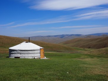 A Mongolian ger on the green steppes.