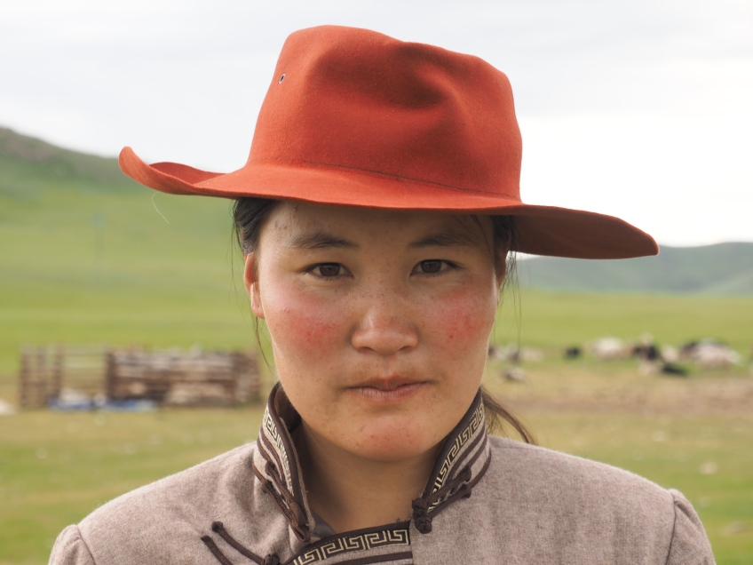 The eldest daughter of the family I stayed with, posing in my Mongolian deel and Akubra.